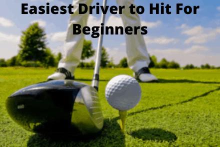 Golf driver next to golf ball