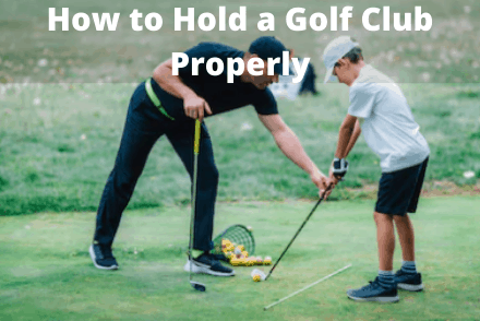 Kid learning how to hold golf club